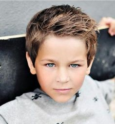 I love love love this little boy's hair cut. I just might have to do this with Kadens hair like this for the beginning of the school year!