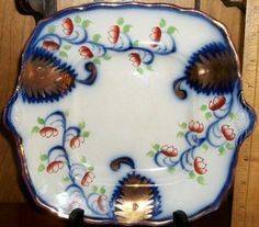 "8 1/2"" X 9 1/2"" Flow Blue Gaudy Welsh plate.  Looks like it might be the plate for a butter dish without lid."