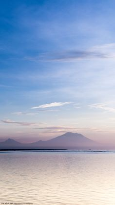 Volcanos in Blue | Indonesia  A shot I took on a gorgeous dawn from Nusa Dua on the East Coast of Bali. Another breathtaking morning spent capturing some misty views of Mount Agung Bali's highest and most active volcano, in the coolest of tropical light.  Enjoy & Share.