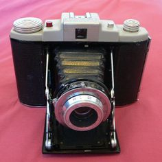 The Kodak 66; made in the UK in the late 1950's, this was a relatively simple camera but with a very useable lens. When new in 1958 it was already old-fashioned, and cost £9/6/0 (nine pounds six shillings and no pence) which is equivalent to approx £180. An Agfa Isolette II with almost identical specs would have cost just under £15 in 1958. By 1963 the camera had been discounted down to £3/2/8 (that's still £62 in today's money).