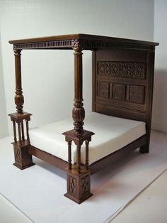 Amazing intricacy on the legs! 1:12 scale dollhouse miniature Bed of Wares