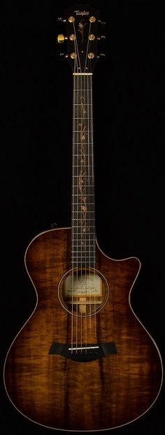 Taylor Wildwood CV K22CE Koa. If I only knew how to play, guess I gotta learn now :)