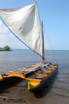 Hawaiian Double Hulled Canoe By: Andrew A Hawaiian double hulled canoe awaiting a crew below Pu'ukohala Heiau