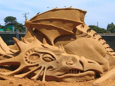 "sand sculpture ""Sleeping Dragon"" by fergus mulvany"