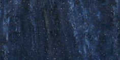 Corian® Elderberry - white clouds with gold speckles, swirling in a dark blue universe.