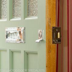 Green 1930s front door painted light green