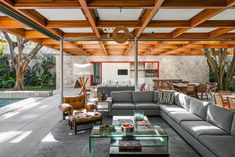 Photo 12 of 283 in Best Living Sectional Photos from This Brilliant Brazilian Abode Was Designed Around an Imposing Tree - Dwell