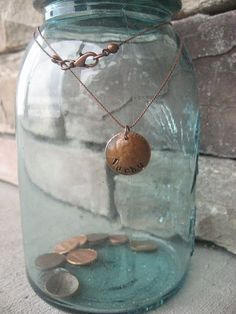 This tutorial for making a lucky penny necklace is the best I've seen.