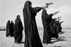 Jean Gaumy IRAN. Tehran. 1986. Veiled women practice shooting on the outskirts of the city Magnum Photos Photographer Portfolio