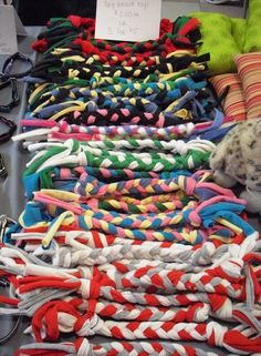 Inspiration~Old tshirts become tug toys #recycle #dogs - *instead of the ropes that they pull apart!: