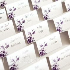 Purple Escort Cards. cute idea but with orchids or lavender as the flower?