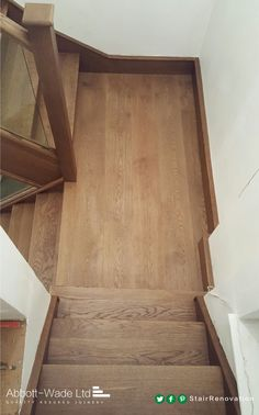 Oak staircase renovation incorporating embedded glass balustrade