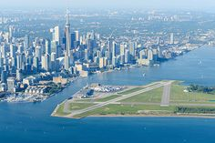 Billy Bishop Toronto City Airport (Canada): </strong>Jet booking service PrivateFly asked a global panel of experts and aviation fans to vote for the most scenic airport landings. Canada's Billy Bishop Toronto City Airport took place in the 2017 poll. Toronto City, Toronto Island, Toronto Canada, Toronto Skyline, World's Most Beautiful, Beautiful Places In The World, Beautiful Pictures, London City Airport, New Zealand