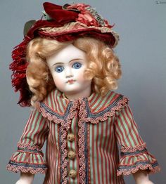 "In the 19th century, porcelain became the standard in doll making, particularly in the popular ""bebe"" dolls from France."