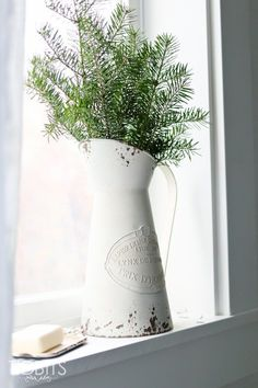 Make good use of extra branches trimmed from the Christmas tree | French Farmhouse Christmas Home Tour