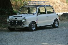 1971 Austin Mini Cooper, with all the right jewelry: rally lights, ultralight wheels, and a sweet roof rack.