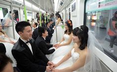 Mass wedding on tube - City Council officials in Wuhan, China, organised a mass wedding on the city's underground train network to celebrate its 10th anniversary.The council appealed via the local paper for couples to agree to be married on the underground, and to tell their underground related stories to local media.