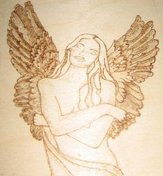 Angelo pirografato su legno.  Barbara Guarini