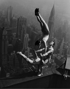 A balancing act atop the Empire State Building in 1934.