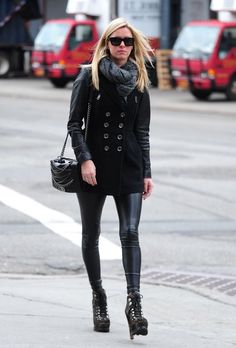 Nicky Hilton wearing Burberry Brit Leather Sleeve Double Breasted Coat Chanel Fall 2013 Enchained Boy Bag Azzedine Alaia Calf-hair Dalmatian printed ankle boot