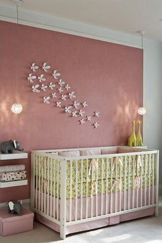 Love the pink and green… especially the little giraffes! Floating shelves… LOVE!