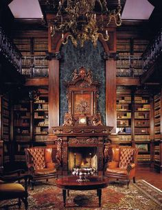 Love the two-story library, all the marble above the fireplace. Love the leather wing back chairs. It's all over the top but stunning to look at.