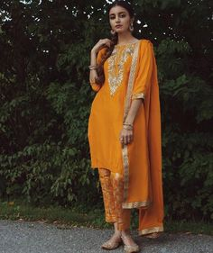 email sajsacouture@gmail.com for this exquisite orange indian suit!
