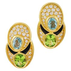MARINA B. A modern pair of 18k yellow gold earrings designed by Marina B. featuring great quality diamonds with aquamarines, peridots and a hint of black onyx for contrast. Italy ca. 1990s