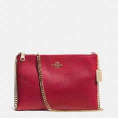 The Zip Top Crossbody In Leather from Coach.Is it has room for mini?