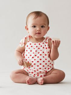 Designer Baby Girls Clothes - Organic Cotton Broken Tricycle Apples Gardening Onesie  Irresistibly sweet Apples Gardening Onesie by Broken Tricycle!  Made from 100% super soft organic cotton this gorgeous baby girls onesie is perfect for all summer outings whether it be lunch at grandma's or a play date with her bestie!  #designerbabygirls #designerbabyclothes #babyfashion #playsuit #organiccotton #littlebooteek #brokentricycle