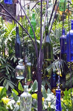 Hang them with fancy wire wrap!!  would be neat from a WHITE ARBOR!!!  HUN !!!~!!!  Drink up!!