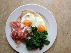 Sunny eggs, prosciutto & kale © Rawduck