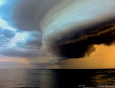 In this stunning capture by Gonzalo G. Useta, we see a massive shelf cloud off the coast of Montevideo, Uruguay. A shelf cloud is a low, horizontal, wedge-shaped Arcus cloud. They are typically attached to the base of a parent cloud, which is usually a thunderstorm, but could form on any type of convective cloud.