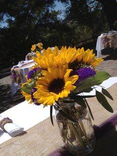 Sunflowers in Mason jars with burlap table decor