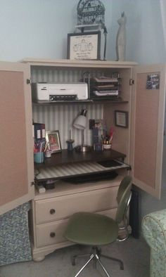 I finally finished converting this old armoire into a desk. I added a pull-out shelf for my laptop and cork inside the doors, then lined the back and pull-out with blue & white striped wallpaper. I love how it turned out!