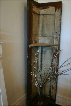 great idea - old door as a corner shelf