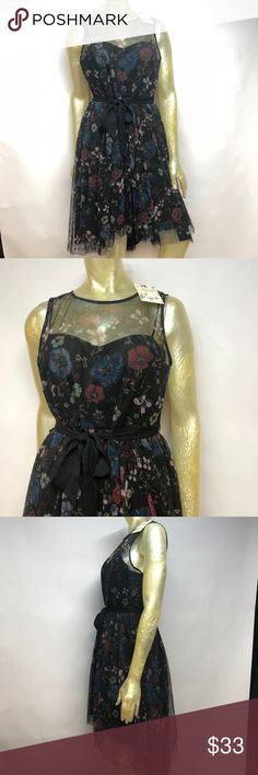 """Lauren Conrad Snow White Collection Dress Sz 6 Lauren Conrad Snow White Disney Collection Floral Mesh Dress with Waist Tie Belt Women's Size 6  Brand New with tags. Gorgeous Lauren Conrad Disney Collection Dress. Features a mesh floral fabric that is fully lined. It is also a high low style dress. Please refer to images for more details about this item. If you have any questions about this item. Measurements are taken with the item laying flat.  Armpit to armpit: 19"""" LC Lauren Conrad Dresses"""
