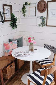Small breakfast nook with tulip table and bench, black, white, and wood tones with a dash of pink for Spring! #springdecor #pinkdecor #farmhousedecor