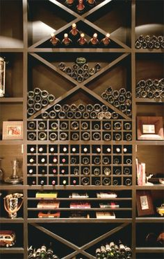 Cellar style display-for behind the bar? combo of books, bottles, product