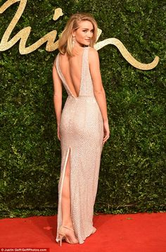 Peachy: Rosie showed off a glimpse of her fabulous legs and slim figure as she posed up a storm at the awards