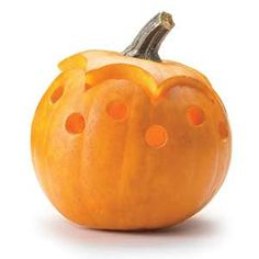 Carved decorative ventilation holes in a small pumpkin. Rub the interior with cinnamon and cloves and place a tea light inside for a wonderful autumn scent.
