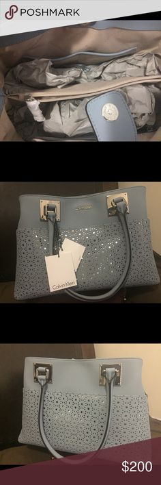 Calvin Klein Purse Beautiful baby blue hand purse that has never been used. Hopefully it can be yours!! Calvin Klein Collection Bags Shoulder Bags