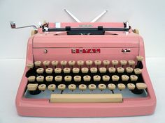 Professionally Serviced PINK 1950s Royal Typewriter with New Rubber Platen and Carry Case and Owners Manual. $675.00, via Etsy.