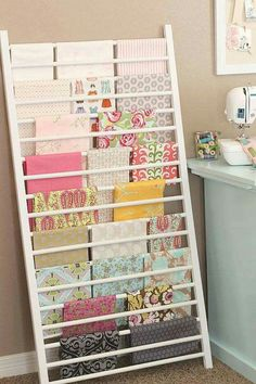 A repurposed crib railing can be so useful in a craft or sewing room!