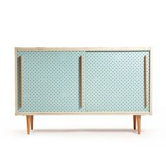 Vintage cabinet used as a shoe cabinet with sliding, perforated door for the ventilation. Easy and really nice design. Original colors and finish in vintage condition with signs of