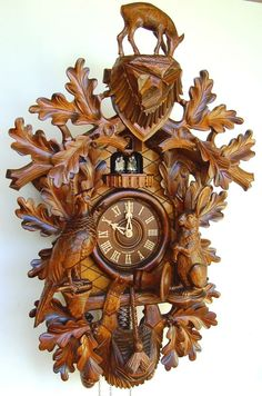 "Model #8TMT 245/7R Musical Hunting Cuckoo Clock with Wildlife   •Musical Hunting cuckoo clock with deep, rich carvings   •34"" Tall   •German Regula, 8 day movement (must be wound weekly)   •Music box plays one of two melodies, after the call of cuckoo, at the top of the hour.   •2 Melody, 36 note music box   •Beautifully hand-carved   •4  Dancing figurines   •Wooden dial   •Wooden hands   •Full grazing deer on crest   •Wooden cuckoo bird   •Night shut-off switch   •Almond stain"