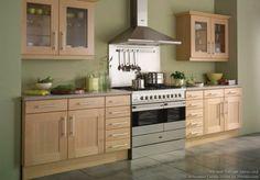 Light beech kitchen cupboards. Olive green walls. LIKE!