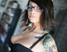 Glasses. Tattoo. Very pretty.