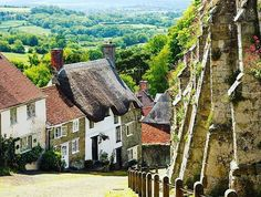 Shaftesbury in county #Dorset, #England is famous for this steep cobbled street of Gold Hill. Yikes!  #travelinspirations #england #adventures #vacation #outnabouttravel #travelsolo_notalone