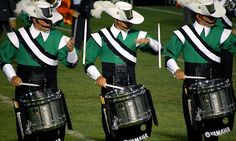 Cavaliers snare line performing some drum stick magic.